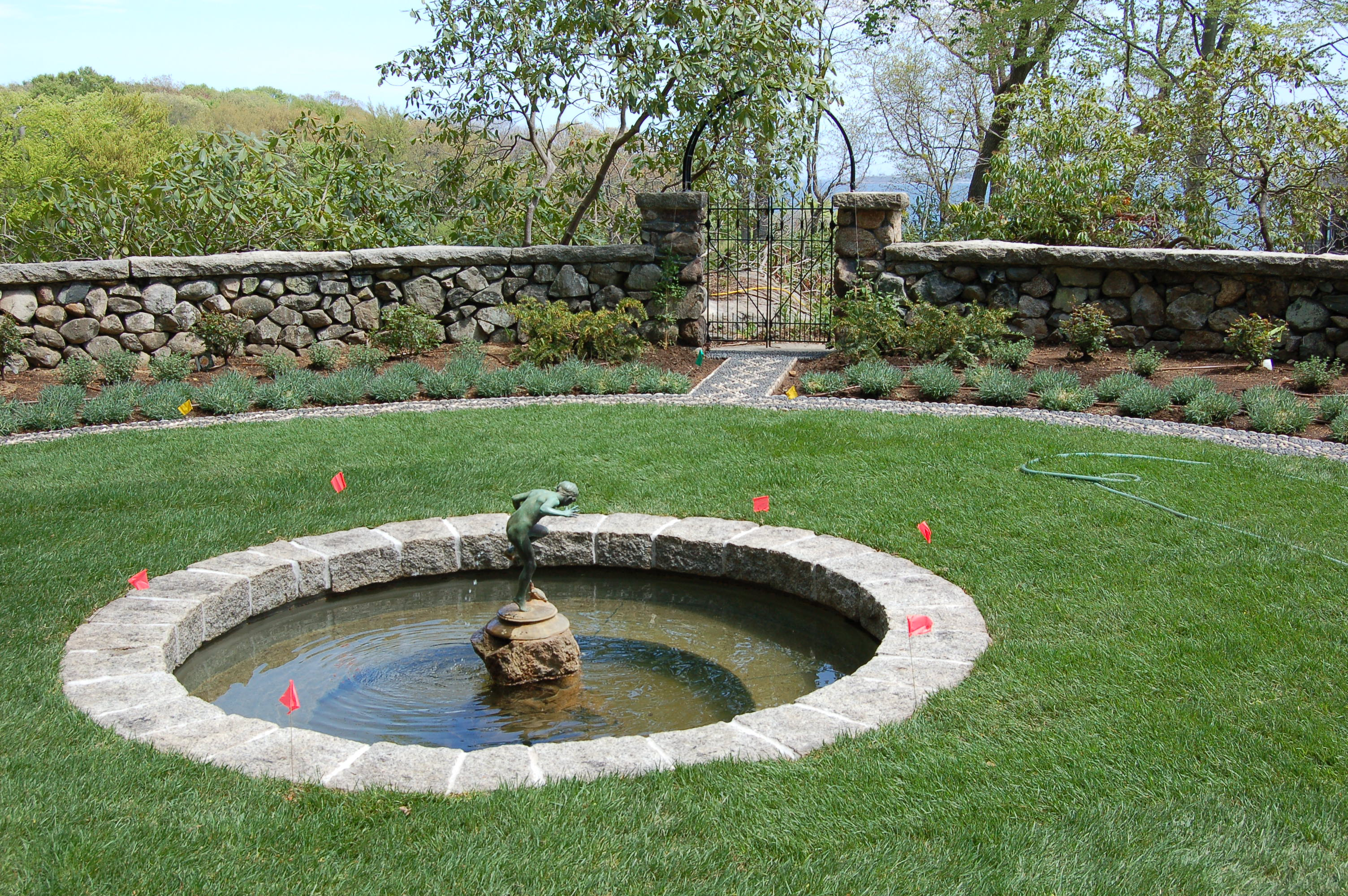 Masonry work in beverly ma pond with granite coping for Concrete fish pond construction and design